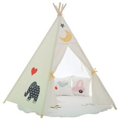 Reach for this delicately embroidered teepee that offers a gentle meeting spot for your child and her imaginary friends. It doubles as a mini-napping nook — so please don't disturb. Dreams happen here.