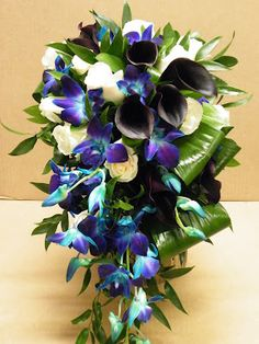 Blue dendrobium orchid, purple calla lily, ivory rose and foliage #Purple #teardrop #bouquet ... #purple #wedding … Wedding #ideas for brides, grooms, parents & planners https://itunes.apple.com/us/app/the-gold-wedding-planner/id498112599?ls=1=8 … plus how to organise an entire wedding, within ANY budget ♥ The Gold Wedding Planner iPhone #App ♥ For more inspiration http://pinterest.com/groomsandbrides/boards/ #fuchsia #plum #indigo #peacock cascading blue orchid bouquet, bridal bouquet purple and blue, bridal bouquets, calla lilies, purpl flower, purple wedding, deep purple and blue wedding, cascade blue bouquet, purpl calla
