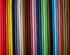 Choose from our 43 different textilcables and revive your lamps! All of our textilcables have doble lining, so it's safe to use them in your home. The two and three cord cables (2x0,75 and 3x0,75) come with a choice of 43 different colours.  Please write as note the name of the color which you would like to order!  neon // green neon // orange neon // pink neon // yellow pastel // blue Pastel // green pastel // purple pastel // turquoise pastel // yellow pastel // pink basic // purple basic…