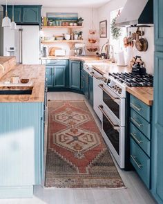 This Is How You Rock Blue Cabinets in the Kitchen cozy blue kitchen w. This Is How You Rock Blue Cabinets in the Kitchen cozy blue kitchen with butcher block countertops ideas Modern Farmhouse Kitchens, Farmhouse Kitchen Decor, Home Kitchens, Galley Kitchens, Country Kitchen, Modern Kitchen Decor, Modern Industrial Decor, Galley Kitchen Design, Blue Kitchen Decor