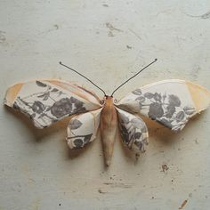 Textile wall art of a moth. Vintage rose illustration on wings.