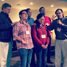 Bishop Philip Jones  praying with Ignatius  & Anna Ng at the Anglican Mission Summit at Port Alberni http://www.theamcanada.ca