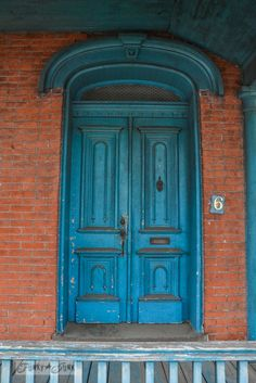 Gorgeous blue door with so much character and patina, found in Gettysburg, PA. By Funky Junk Interiors-Touring historic Pennsylvania - beautiful old brick and blue house Exterior House Colors, Exterior Paint, Front Door Lighting, Orange Brick, Funky Junk Interiors, Old Bricks, Front Door Colors, Brick Building, House Front