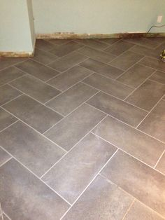 Trafficmaster Ceramica 12x24 Coastal Gray Herringbone Pattern L And Stick With Grout For Layout
