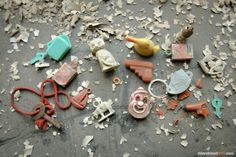 Collection of toys left on a window sill - Creedmoor State Hospital www.abandonednyc.com