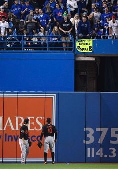 Hyun Soo Kim and Adam Jones, BAL, look toward fans after a can was thrown at Kim while he making a catch - not a nice scene for Toronto//Oct 4, 2016 AL Wild Card game at TOR