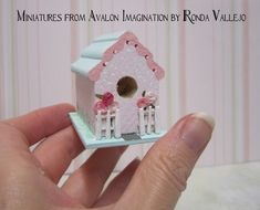 Reduced Price on Miniature dollhouse shabby chic handmade birdhouse in pink and mint green with roses and picket fence.  via Etsy.
