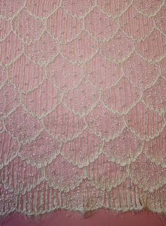 A new lace that will be in stock from April 2017. A myriad of embroidered leaves small and large, with the edge of the lace shaped to the contours of the pattern. Translucent sequins, bugle beads, and seed pearls are delicately placed to highlight the pattern LISTING IS FOR 1 YARD! WE CAN GET AS MANY YARDS AS YOU NEED! We are the go to source for designers and dressmakers looking to add a unique touch to their stunning creations. With bridal and event fashion always changing, it can be a…