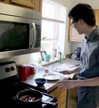 Lafayette Journal & Courier 's arts and entertainment reporter Wei-Huan Chen cooks crickets and mealworms in butter with garlic and red pepp...
