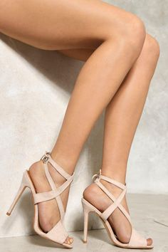Ain't anything to be cross about with these babies. These heels come with cross over strap detail, tie closure at back, stiletto heel, and peep-toes. Perf for fancy occasions NASTY GAL