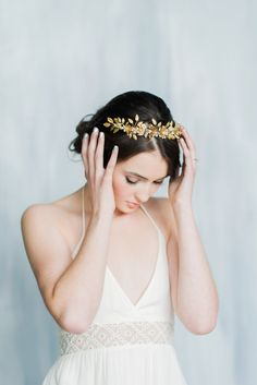 We absolutely adore this truly beautiful gilted crown. Beautiful hand stamped flowers are delicately placed through this beautiful leaf crown. Each flower is finished with a Swarovski pearl. Gorgeous hand stamped leaves in various designs finish off this beautiful regal crown as tiny pearls scatter between the vines and leaves. This crown is hand wired onto a gold band with 2 combs on both ends of the band for perfect support. Can be worn as a headband (no combs) or as a tiara style crown (2…