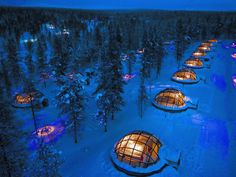Stay in a magical glass igloo, snow igloo, or log cabin at Finland's Kakslauttanen Arctic Resort