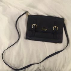 Kate spade cross body This Kate Spade Allen Street Neil crossbody black bag has never been carried before, with a removable strap this bag doubles as a clutch. This beautiful leather bag has gold hardware and woven bookstripe printed poly twill lining, magnetic closure and exterior slide pocket. Dust bag included. kate spade Bags Crossbody Bags