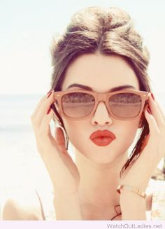 Red lips and nails, sunglasses and vintage updo