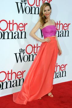 """For the L.A. premiere of """"The Other Woman,"""" Leslie Mann was pretty in a bold fuchsia bandeau top and red skirt from Monique Lhuillier. [Photo by Steve Granitz/WireImage]"""