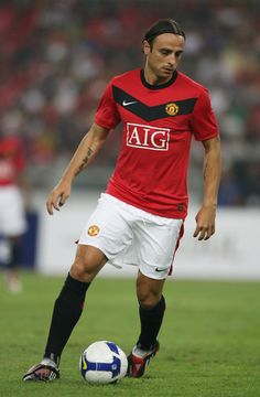 Dimitar Berbatov of Manchester United runs with the ball during the pre-season friendly match between Manchester United and Malaysia XI at Bukit Jalil National Stadium on July 20, 2009 in Kuala Lumpur, Malaysia.