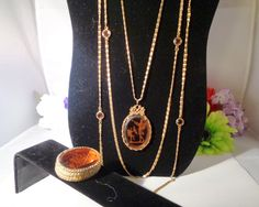 """Reduced! Goldette Necklace  2"""" Amber Intaglio Cameo Pendant of Cupid & Venus w/Swarovski Crystals and Hoffman Intaglio Cameo Amber Pill Box. The Price for today only is $48.00. The Crystals on the Necklace are by Swarovski Crystals. Free Shipping to the United States.  www.CCCsVintageJewelry.com"""
