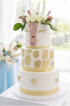 Take a look at the gorgeous tiered giraffe birthday cake topped with fresh flowers at this safari 1st birthday party. See more party ideas and share yours at CatchMyParty.com #catchmyparty #partyideas #4favoritepartiesoftheweek #safari #safariparty #safaricake #giraffecake #boy1stbirthdayparty