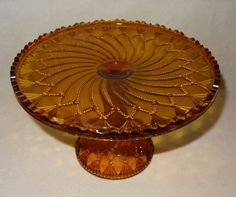 """EAPG """"Cord Drapery"""" pattern Amber Cake Stand. NATIONAL GLASS CO. No. .350 INDIANA (OMN) by National Glass Company (IT&G Works) (Greentown-IN, Operated: 1899-1903), 1901 Pickled Olives, Chocolate Shapes, Condiment Sets, Pickle Jars, Glass Company, Cake Plates, Amber Glass, Drapery"""