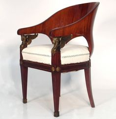 Pair of Russian Empire Armchairs   From a unique collection of antique and modern armchairs at https://www.1stdibs.com/furniture/seating/armchairs/