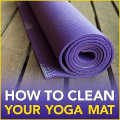 """A purple rolled up yoga mat on a wood floor with the words """"How To Clean Your Yoga Mat"""""""