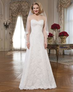 Strapless sweetheart all over alencon lace A-line, with buttons over the back zipper, and a chapel length train.