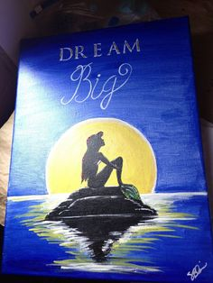"""Ariel Silhouette. Did this exactly without the """"dream big"""" and without the touch of red and green to ariels hair and tail. The rock was more dark gray but the painting was pretty much the same. Made for a friend. -SCB"""