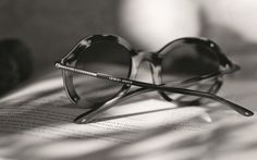Mimi wears an iconic sunglass style from the Giorgio Armani Frames of life collection.