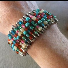 DIY Jewelry: Safety Pin Bracelet. My friends gave me one of these when I was a kid when they came home from vacation. I loved it and have wanted to make another one ever since someone at school stole it. It's on the list now.