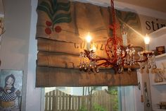 Red chandelier and burlap curtains