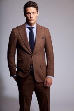kinda liking the brown suit idea...maybe with sage green tie or ...