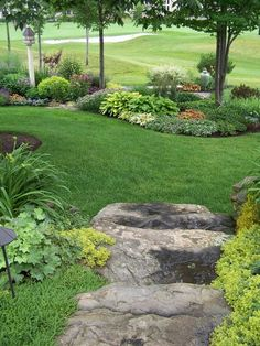 Golf course garden, A garden with lots of curves inspired by the curves in the golf course sand traps, is viewed from many angles. There is no front or back but it still has lots of layering. It mixes shrubs, perennials, grasses and annuals., Yards Design