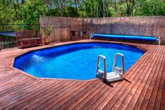 Do you need some inspiration for pool deck designs? 20 awesome above ground pools with decks, showcasing the myriad shapes and styles available on a budget. Above Ground Pool Liners, Best Above Ground Pool, Above Ground Swimming Pools, In Ground Pools, Semi Inground Pools, Oberirdische Pools, Cool Pools, Lap Pools, Doughboy Pool