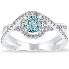 This is like the one we looked at at the store where the girl colored the cz to see what it would look like.  The only difference is the lower band didn't have the diamonds