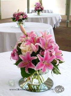 Google Image Result for http://www.blossomweddingflowers.co.nz/p7hg_img_3/fullsize/V061-wedding-reception-table-flowers-pink-lilies-peonies-fishbowl-vase_fs.jpg
