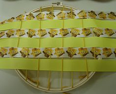 Make the weaving loom with an embroidery hoop.