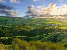 Morning sun touches the hills and sand dunes of Inishowen, Ireland.
