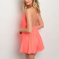 Flirty Orange Chiffon Romper Cute and Flirty Neon Coral Orange Chiffon Romper! Features Double Spaghetti Straps, a Wrapped Bodice, Full Lining, Zip Closure, and an Open Back with Criss Cross Straps!   Size Available: S,M,L  *Let me know which size you'd like, and I will create you a listing* Thank you, Xo Pants Jumpsuits & Rompers