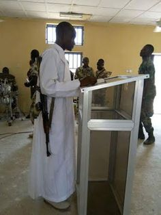 Military Priest conducting service with his Ak-47 rifle   Military Priest  With the high rate of boko haram attacks in the North East of Nigeria a military priest at St. James Catholic Cathedral Military Base Yobe State was recently pictured fully armed with his AK-47 rifle. Asides Borno and Adamawa state Yobe state has also fallen greatly to attacks by Boko Haram attacks in recent times with several deaths recorded. News
