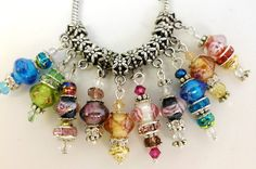 10 Beautiful one of a kind Lampwork Charms. Starting at $5 on Tophatter.com!