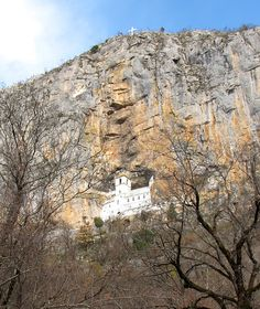 Ostrog Monastery, Montenegro. The Monastery of Ostrog is built into an almost vertical cliff, high up in the large rock of Ostroška Greda, in Montenegro. It is dedicated to Saint Basil of Ostrog.