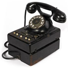 The introduction of the Swedish Bakelite phone revolutionized the way telephones were designed and manufactured between the 1930's-1960's. Made of the polymer called Bakelite, this unique ornamental piece is perfect for adding a vintage look to your decor! Available on Artisera