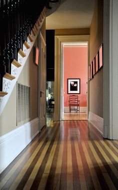 The wood floor in the entry hall of Sallye Perrin's home is laid with alternating strips of white oak and walnut. The house, built in 1857, is on the Maryland Home and Garden Pilgrimage on April 28.