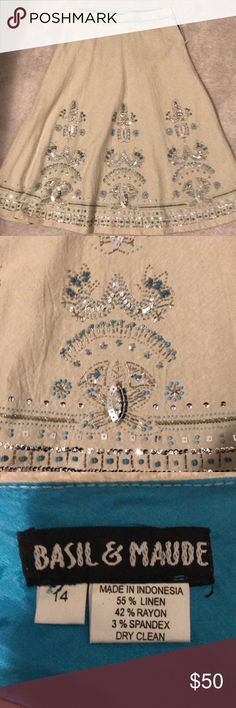 NWOT size14 A-line tan linen skirt with beading Tan linen beaded skirt with turquoise, silver and grey beads. Fully lined with turquoise color lining. Never worn. basil & maude Skirts A-Line or Full
