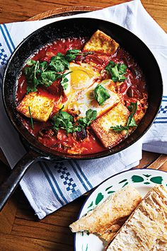 shashouka-eggs braised in spiced tomato sauce with haloumi cheese ... brunch for dinner!