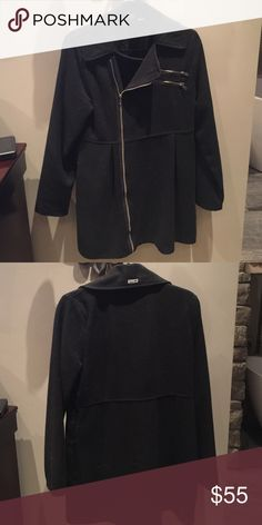Black peacoat Roxy black peacoat with zipper. Great style and fit. Tapered near waist then flares a bit. Pockets for your hands and zippered lapel pockets. Beautiful coat. Roxy Jackets & Coats Pea Coats