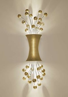 """Lighting is the bling of your home; its jewelry, so to speak. So why not adorn your home in something with a little """"POP!"""" This bubbly line of sconce..."""