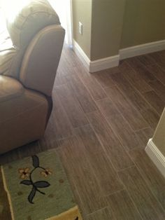 "plank tile floor installation in a condo in South Tampa, Florida. the tile was Florida Tile - Natura ""Charleston Brown"" 6x24"