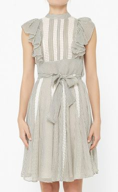 I actually kind of like this frilly dress. Reminds me of Alice from Brady Bunch :)
