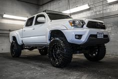 Newly Lifted 2013 Toyota Tacoma 4x4 Truck For Sale with custom wheels and LED light rack| Northwest Motorsport